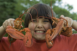 Royce James gets excited about a lobster feast at Warren Island State Park, Maine