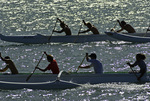 Practicing for a race in outrigger canoes, off Molokai