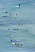 Wannabe surfers loll in the gentle waves off Waikiki Beach, Honolulu, Oahu