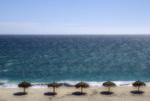 Palapas line the beach along the East Cape, between San Jose del Cabo and Cabo Pulmo, Baja California Sur, Mexico