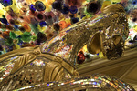 Below a ceiling of Dale Chihuly art glass, a good luck horse lures gamblers to the Bellagio Casino, Las Vegas, Nevada