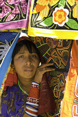A Kuna woman takes shade within her molas, Kuna Yala, San Blas, Panama