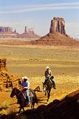 Riding horses through Monument Valley, Arizona