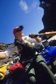 Erica rows thru Waltenberg Rapid on the Colorado River, Grand Canyon National Park, Arizona