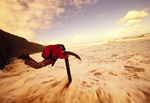 Jordan Wright swings on the anchor of the wrecked historic ship 'Fiji', on Wreck Beach, Great Ocean Walk, Victoria, Australia