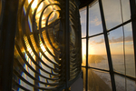 Fresnel lens of Cape Otway Lightstation, lit by the rising sun, Great Ocean Walk, Victoria, Australia