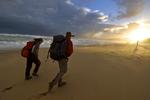 A couple hikes at sunset on Johanna Beach, Great Ocean Walk, Victoria, Australia