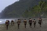 Embera people stroll on the beach near their home in the Darien Jungle of Panama