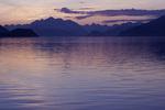 Sunset over the Fairweather Range on a sunny evening in Glacier Bay National Park, Alaska