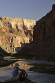 A river runner looks down the Colorado River at Nankoweap, Grand Canyon National Park, Arizona