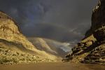A monsoon rainbow glows above the Colorado River in Grand Canyon National Park, Arizona 