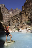 The lime rich waters of Havasu Creek empty into the Colorado River in Grand Canyon National Park, Arizona
