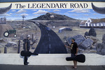 A traveling musician stands in a highway mural scene on old Route 66 in Tucumcari, New Mexico