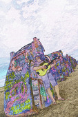 A minstrel plays his guitar at Cadillac Ranch west of Amarillo, Texas