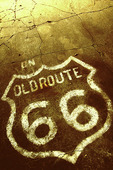 A painted Old Route 66 sign at a gas station in Alanreed, Texas
