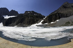 Ice from Grinnell Glacier slowly melts in Upper Grinnell Lake, Glacier National Park, Montana
