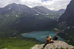 Hikers rest and enjoy the view of Lower Grinnell Lake, from the Grinnell Glacier Trail, Glacier National Park, Montana