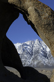 An unnamed granite arch in the Alabama Hills, with Mt. Whitney rising in the background, Owens Valley, California