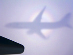 Seeing its shadow and the specter of the brocken, an Alaska Airlines 737 flies north to Alaska