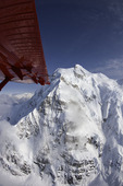 K2 Aviation flies near the dangerous wall of Mt. Hunter in Denali National Park, Alaska