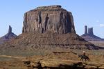 A Navajo man rides out to John Ford Point at Monument Valley, Arizona