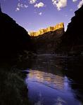 Sunrise light illuminates a rock wall in Marble Canyon, at North Canyon, Grand Canyon, Arizona