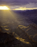 Stormlight breaks through clouds close to sunset, from Lipan Point, Grand Canyon National Park, Arizona