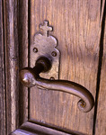 A stylish vintage wrought iron door handle at the Mission San Antonio de Padua, California
