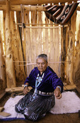 Mary Yazzie cards wool before the loom, Page, Arizona
