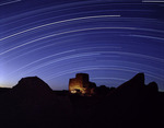 Star tracks arc across the sky over Wukoki Ruin, Wupatki National Monument, Arizona