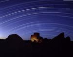 Star tracks arc across the sky over Wukoki Ruin, Wupatki National Monument, Arizona