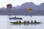 Hot air balloons and rowers in Thompson Bay , during the Havasu Balloon Fiesta, Lake Havasu City, Arizona
