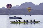 Hot air balloons and rowers in Thompson Bay , during the Havasu Balloon Fiesta, Lake Havasu City, Arizona