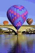 Hot air balloons over the London Bridge, during the Havasu Balloon Fiesta, Lake Havasu City, Arizona