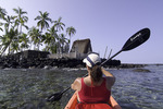 Kayaking near temple sites at Pu'uhonua o Honaunau National Historic Park, Big Island, Hawaii