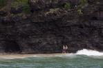 Couple on Kalalau Beach, Na Pali coast, from the Pacific Ocean, Kauai, Hawaii