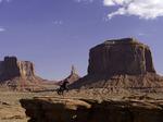 Adrian Jackson rides on John Ford Point, Monument Valley, Arizona