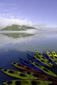 Kayaks await paddlers off Patterson Bay, Inside Passage, Alaska