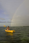 Sunrise and rainbow from a kayak, off the Pines & Palms Resort, Islamorada, Florida Keys, Florida