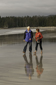 Walking the beach together at Peril Bay, northwest coast of Graham Island, Haida Gwaii, British Columbia, Canada