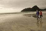 Walking the beach together at Peril Bay, northwest coast of Graham Island, Haida Gwaii, British Columbia, Canada