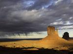 Virga (rain) falls by the Mittens at sunset, Monument Valley Tribal Park, Arizona