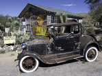 A rusted car survives the desert heat outside the General Store on Route 66 in Hackberry, Arizona