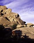 Baxter Black rides his horse near the granite boulders of Texas Canyon, Arizona