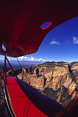 The Red Biplane flies over the wilderness area north and west of Sedona, Arizona