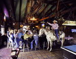 Cowboy Dan Skiver rides his horse into the Wagon Wheel Saloon, Patagonia, Arizona