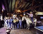 Cowboy Dan Skiver rides his horse into the Wagon Wheel Saloon, Patagonia, Arizona