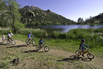 Family cycling by Granite Basin Lake, Prescott, Arizona
