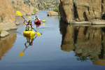 Family kayaking on Watson Lake, Prescott, Arizona