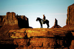 A Navajo cowboy poses on John Ford Point, Monument Valley, Arizona
